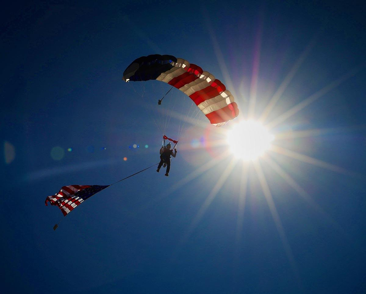Col Bates Jumping with US Flag